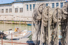 Fishing nets on the quay Stock Photos