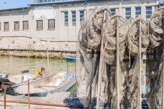Fishing nets on the quay Stock Photos