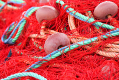 Fishing nets with red, green, orange colors. Royalty Free Stock Images