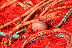 Fishing nets with red, green, orange colors. Stock Photography