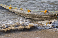 Fishing nets rope and floats in sea water, India Stock Photo