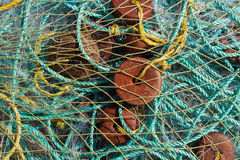 Fishing nets. Ropes. Floats. Bag with fishing nets. Fishing nets assembled together. Fishing nets in a fishing net. Folded fishing nets. Floats and veoёvki are Royalty Free Stock Photo
