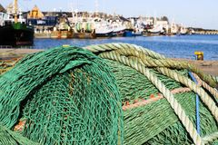 Fishing nets. And ropes in the port stock image