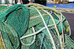Fishing nets. And ropes in the port stock photos