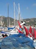 Fishing nets and sailboats. Docked in the village of Andratx, Mallorca, Spain Royalty Free Stock Photo