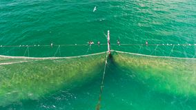 Fishing Nets in the sea water, aerial drone view stock footage