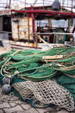Fishing nets. On the shore with a boat in the background Stock Photography