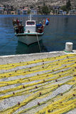 Fishing nets sit on the harbour side of the Greek island of Kastellorizo. Stock Photography