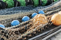 Fishing nets spread out on the quay. At day time stock photo
