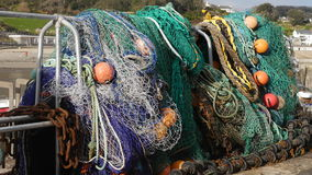 Fishing nets and tackle hanging out to dry. Taken at the fishing port of Lyme Regis in Dorset the UK this photo shows fishing nets and tackle hanging out to dry Stock Photography