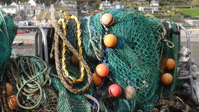 Fishing nets and tackle hanging out to dry Stock Photography
