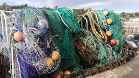 Fishing nets and tackle hanging out to dry. Taken at the fishing port of Lyme Regis in Dorset the UK this photo shows fishing nets and tackle hanging out to dry Royalty Free Stock Photos