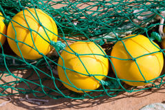 Fishing nets woth yellow buoy Royalty Free Stock Photos