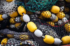 Fishing nets with yellow and white floats Stock Images