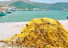 Fishing network. In the bay on the background of the sea and mountains Royalty Free Stock Image