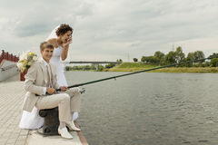 Fishing of a newly-married couple Royalty Free Stock Photography