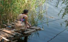 Fishing. A nice girl fishing at riverside Royalty Free Stock Photo
