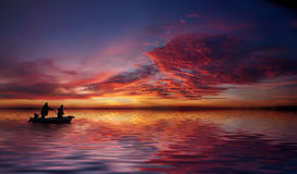 Into the fishing night. Fisher mans are going to fish into the sunset Stock Photo