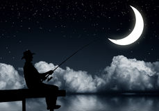 Fishing at night. Silhouette of man sitting at bridge and fishing Royalty Free Stock Photography