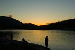 Fishing in Norway. Trout fishing on a mountain lake in Norway Stock Photo