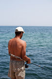 Fishing in the ocean. Success at fishing at daytime Royalty Free Stock Image