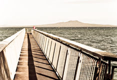 Fishing from ocean beach ramp.Aged photo style Royalty Free Stock Photo