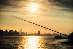Fishing. By the ocean at sunset Stock Photos
