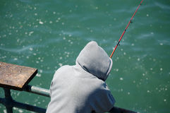 Fishing off the dock Royalty Free Stock Image