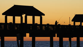 Fishing Off the Pier Royalty Free Stock Images