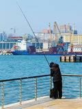 Fishing off the pier in the city of Vladivostok Royalty Free Stock Photography