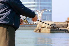 Fishing off the pier in the city of Vladivostok Stock Photo