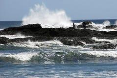 Fishing off the Rocks - New Zealand stock image