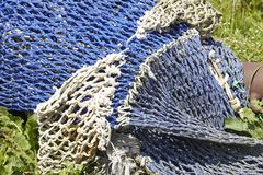 Fishing - Old fishing nets in the harbor Stock Photos