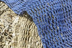 Fishing - Old fishing nets in the harbor Stock Images