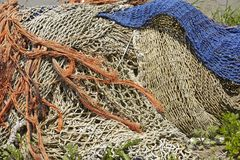Fishing - Old fishing nets in the harbor Royalty Free Stock Image