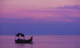 Fishing On The Purplr Dawn Sea Stock Images