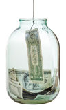 Fishing out dollars banknote from glass jar Royalty Free Stock Photo