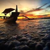 Fishing outrigger returning back Stock Image