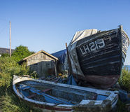 Fishing over. 2 disused ship on the shore stock image