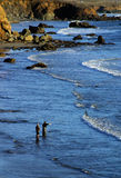 Fishing in the Pacific Ocean. Two men fishing in the Pacific Ocean, along the California coast stock photography