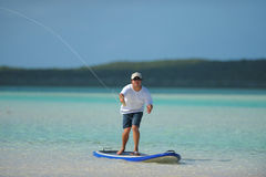 Fishing and paddleboarding Stock Photo