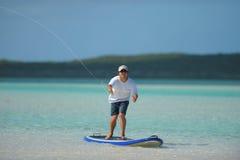 Fishing and paddleboarding Stock Photo
