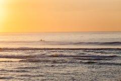 Fishing Paddler Kayak Ocean Sunrise. Ocean dawn fisherman paddler on kayak horizon landscape Stock Images
