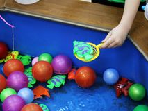 Fishing in the paddling pool. Children`s toys in the pool. stock photos