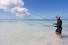 Fishing the paradisiac flats of Belize by feet. This fisherman decided to go fishing the flats by feet. The picture was taken on the flats of Belize, near Belize stock photo
