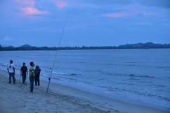 Fishing People. People fishing at near Pantai Cherating Pahang, Malaysia Royalty Free Stock Photography