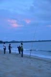 Fishing People. People fishing at near Pantai Cherating Pahang, Malaysia Royalty Free Stock Photos