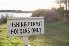 Fishing permit holders only sign at lake in Scotland. Uk royalty free stock photos