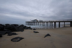 Fishing Pier. Over ocean with jetty in foreground Stock Photography