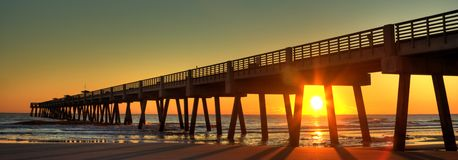 Fishing Pier. A Fishing Pier at Sunrise Royalty Free Stock Images